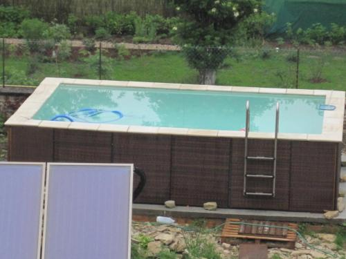 The swimming pool at or near Le Biscottage Arcy-sur-Cure