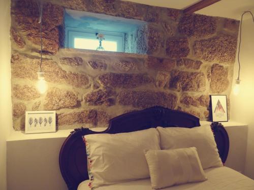 Uma cama ou camas num quarto em Abrigo do Mezio - Country House