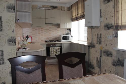 A kitchen or kitchenette at Apartment on Gorkogo 9