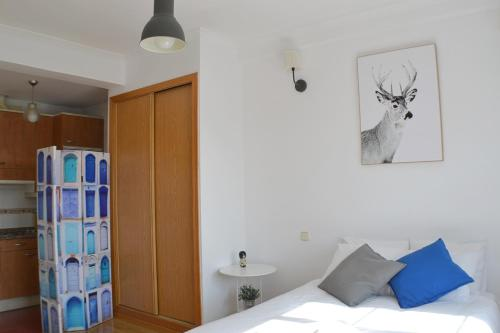 A bed or beds in a room at Panoramic Charming Studio