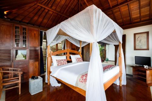 Postel nebo postele na pokoji v ubytování Canang Sari Villas