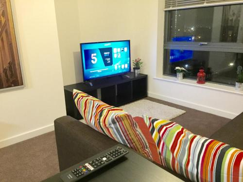 A television and/or entertainment center at Stratford Luxury Apartments