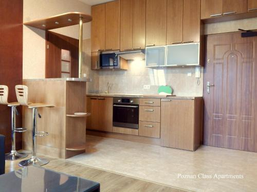 A kitchen or kitchenette at Poznań Class Apartments
