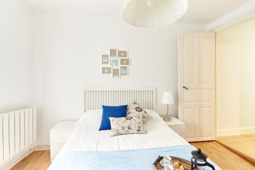 A bed or beds in a room at Apartamento San Lorenzo
