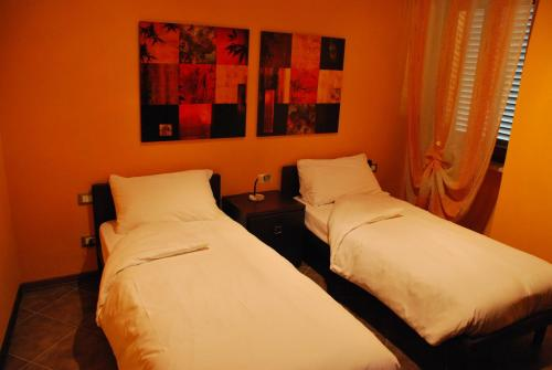A bed or beds in a room at Residence Corona Grossa