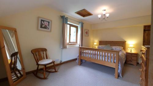 A bed or beds in a room at Troed yr Aran