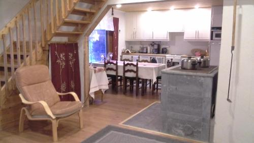 A kitchen or kitchenette at Aamuruskon Holiday Home