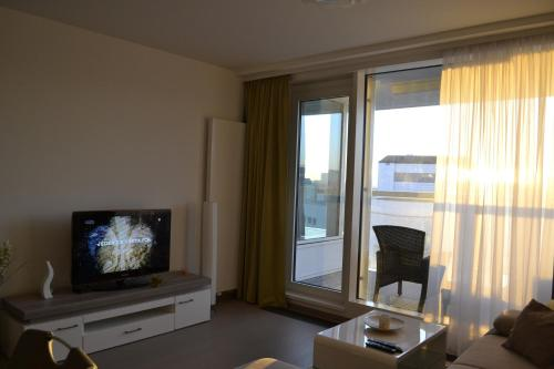 A television and/or entertainment center at Panorama Apartment