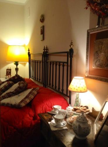 A bed or beds in a room at Podere di Vignantica