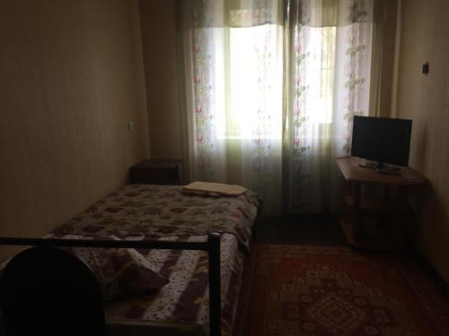 Кровать или кровати в номере Apartment on Belovo 7