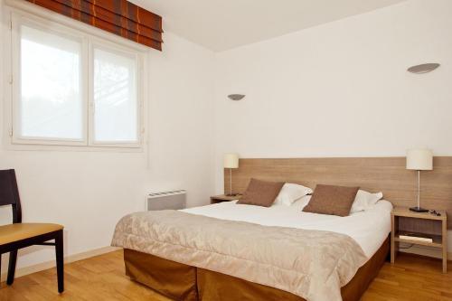 Un ou plusieurs lits dans un hébergement de l'établissement Residhome Genève Prévessin Le Carré d'Or