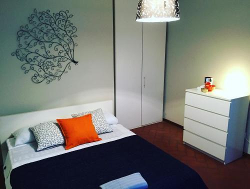 Letto o letti in una camera di Appartamento Luna
