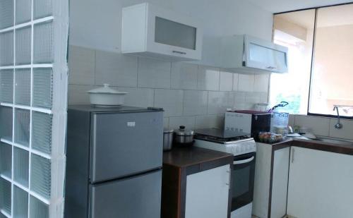 Una cocina o zona de cocina en Water Park Apartment