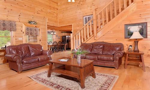 A seating area at Almost Heaven Four-Bedroom Cabin