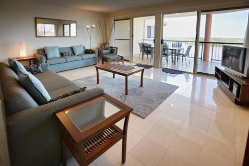 A seating area at On The River Apartments