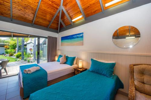 A bed or beds in a room at Island Leisure Resort
