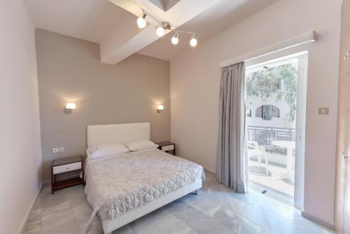 Ein Bett oder Betten in einem Zimmer der Unterkunft Tarra Apartments