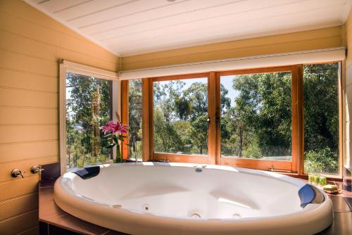 A bathroom at Avalon Private Spa Villa with Beautiful Tree Views