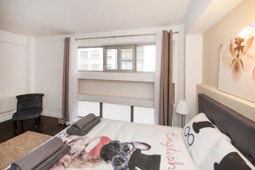 A bed or beds in a room at Beautiful Javel apartment Paris