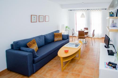 A seating area at Corralejo Center, by Comfortable Luxury