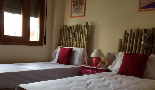 A bed or beds in a room at Apartamento Marina Esuri