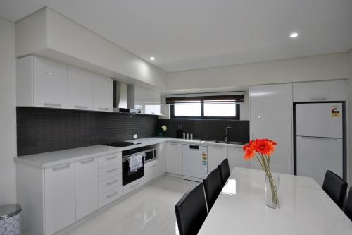 A kitchen or kitchenette at Coastal By Rockingham Apartments