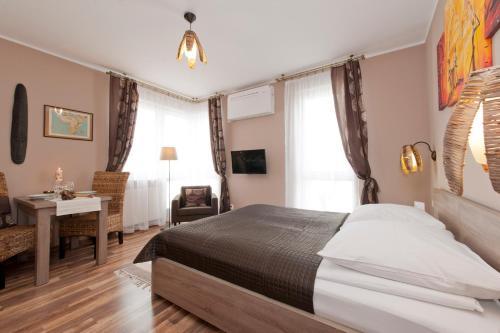 Tempat tidur dalam kamar di Apartamenty Marina House