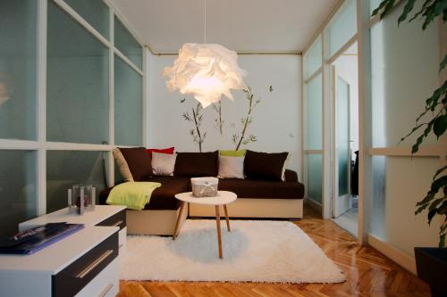 A seating area at Apartment Melon