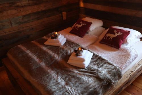 Un ou plusieurs lits dans un hébergement de l'établissement Chalet Les Cleves