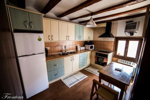 Una cocina o zona de cocina en La Casa del Tio Gato