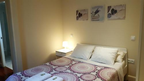 A bed or beds in a room at Olmo Rooms