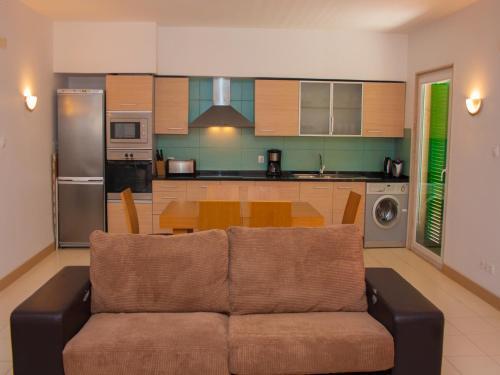 A kitchen or kitchenette at 2 Bedroom Apartment - Vila Verde Resort