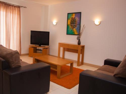 A seating area at 2 Bedroom Apartment - Vila Verde Resort
