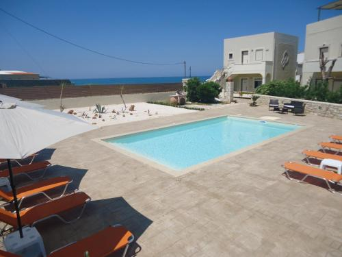 The swimming pool at or near Almyra Apartments