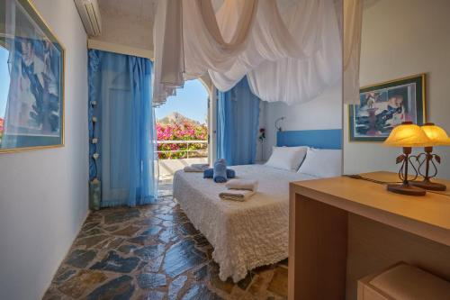 A bed or beds in a room at Villa Palm River