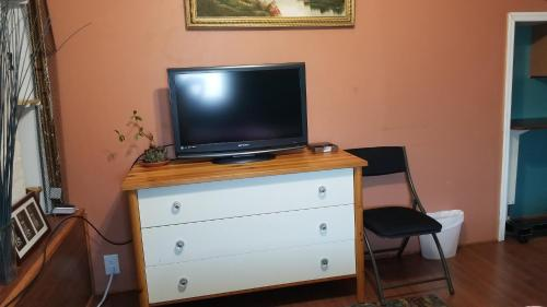 A television and/or entertainment center at Tulsi's Cozy Studio