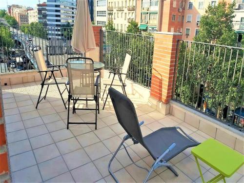 A balcony or terrace at Mc Yolo Apartamentos Avenida De America