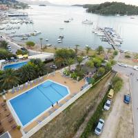 Athos Hotel Opens in new window