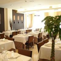 Hotel Asador H.M. Versus