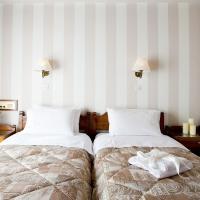 Kouros Hotel Opens in new window