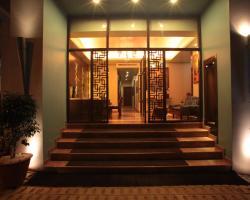 Justa MG Road Hotel