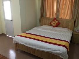 Zhouji Holiday Apartment, Guangzhou (Weichong yakınında)
