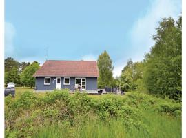 Three-Bedroom Holiday home with a Fireplace in Ørsted, Kare