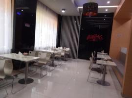 JUNYI Hotel Niongbo Xiangshan Bus Station, Xiangshan (Xianliangzhongchang yakınında)