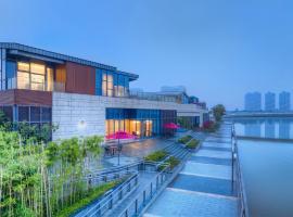 Jiushu Yunlin Boutique Hotel Wuxi Renwen Branch, Wuxi (Chaqiao yakınında)