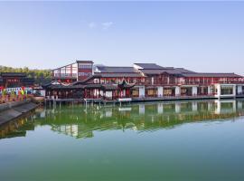 Yixing Yishengyuan Holiday Hotel, Yixing (Shanjuan yakınında)