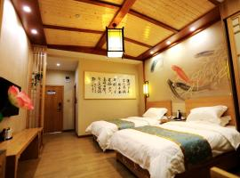 Siguniang Mount Holyland Impression Boutique Hotel, Mount Siguniang (Dengsheng yakınında)