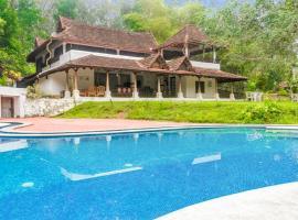 1 BR Villa in Anappara, Thiruvananthapuram (4E61), by GuestHouser, Kallār (рядом с городом Ponmudi)