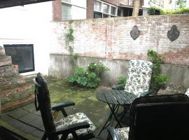 Gezellig appartement IN het centrum met een tuin