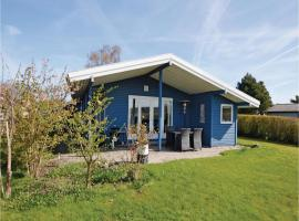 Three-Bedroom Holiday home with a Fireplace in Otterup, Tørresø